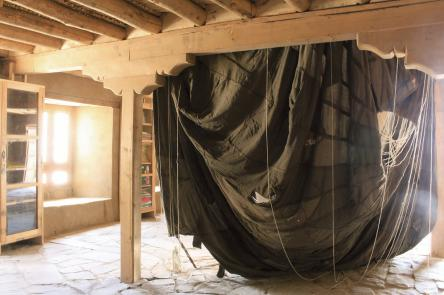 Baptist Coelho Nowhere but here 2015 Siachen thermal shirts and pants, nylon cords and metal rings Diameter of parachute's canopy: 812 centimeters Display dimensions: variable Courtesy: Artist & Project 88, Mumbai