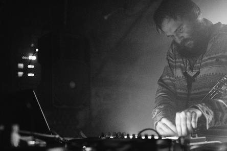 A black and white photo Ben Vince DJing