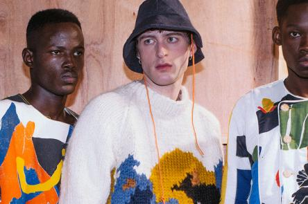 A photo of 3 men wearing patterned clothes at a fashion show, designed by Bethany Williams