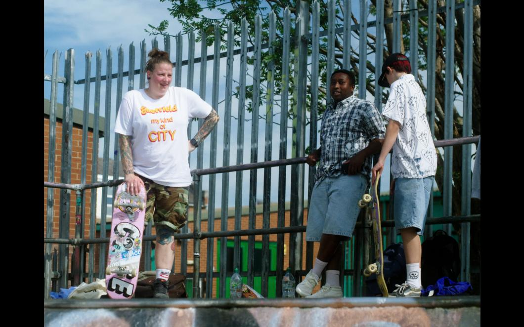 A still from Only in Dev shows three skaters hanging out in a Sheffield skate park