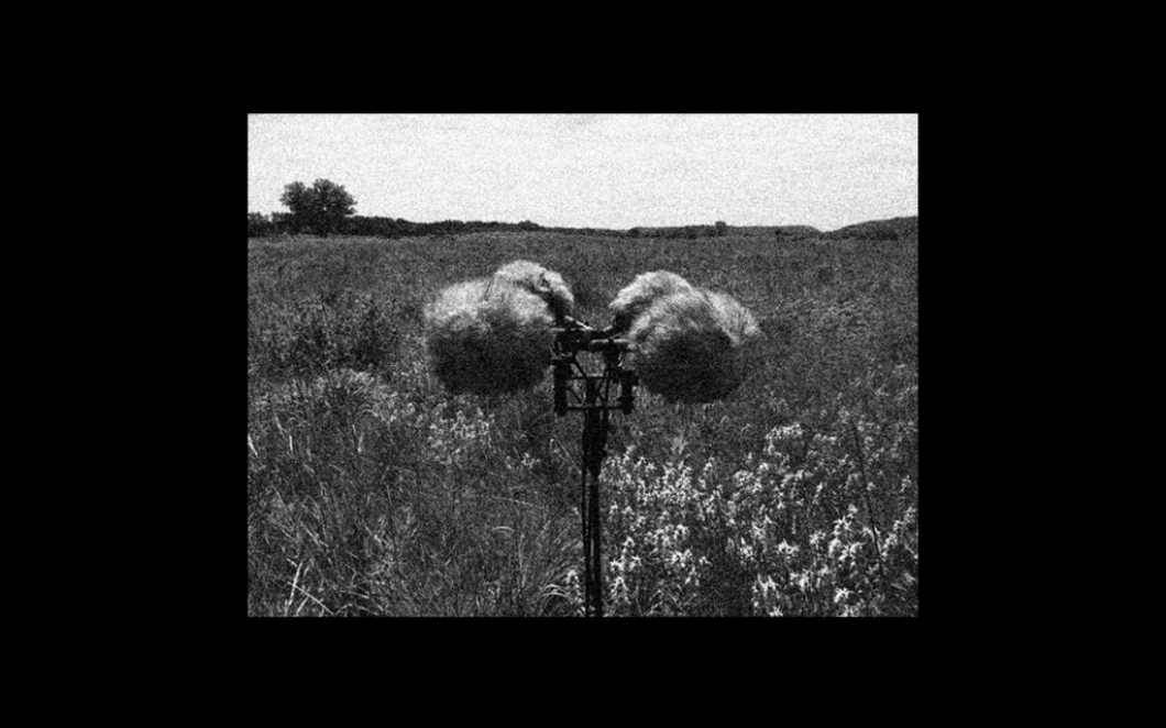 A black and white photo of a field recording device in a field