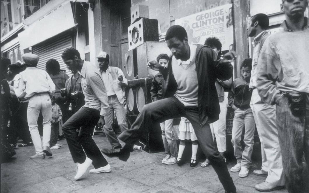 People dancing at a sound system at Nottting Hill Carnival in 1980