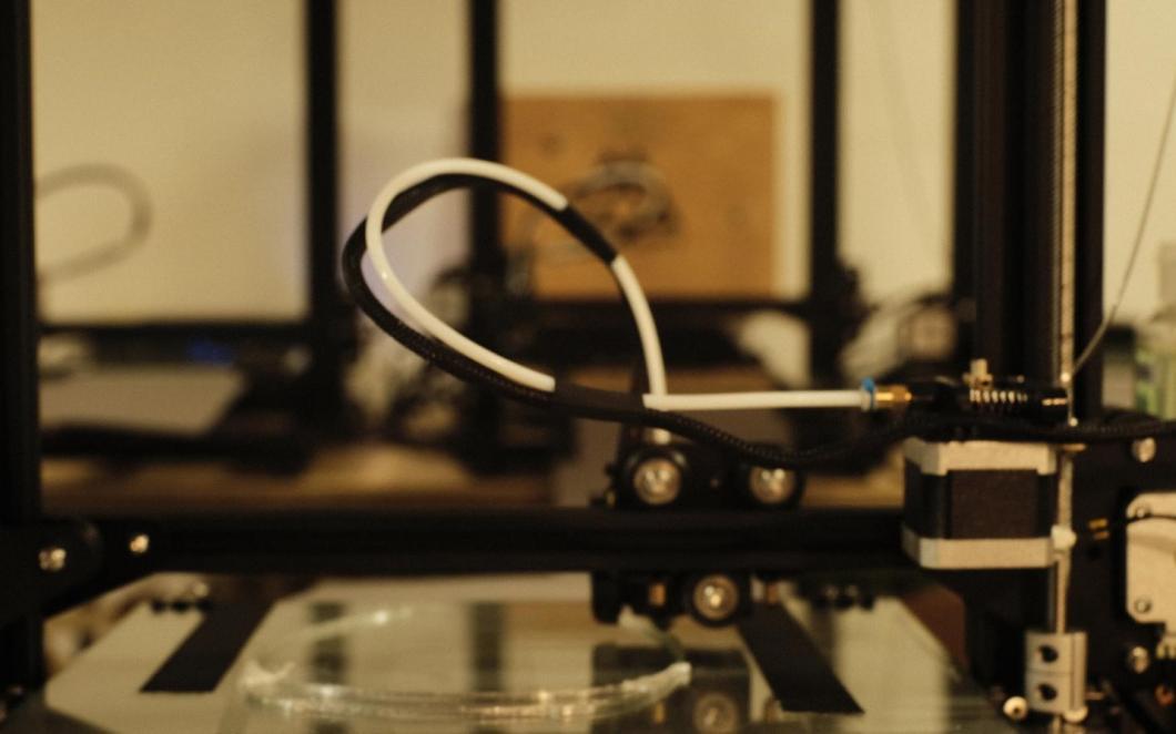 A photo of a close-up a 3-D printer.