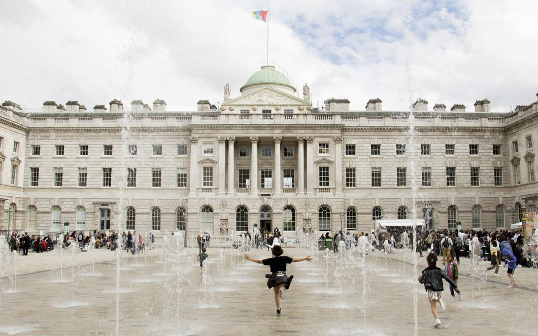 Children playing in the fountains in The Edmond J. Safra Fountain Court, Somerset House