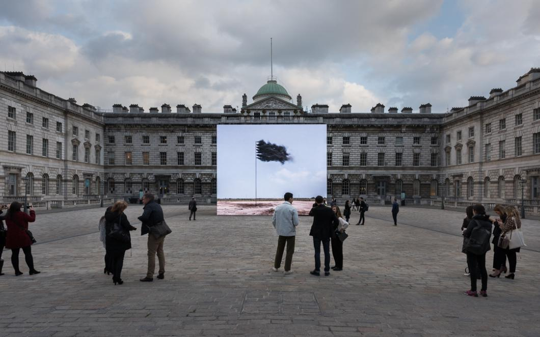 John Gerrard, Western Flag (Spindletop, Texas) 2017. Installation view, Somerset House, London. Photo: Damian Griffiths. Image courtesy the artist and Thomas Dane Gallery, London and Simon Preston Gallery, New York.