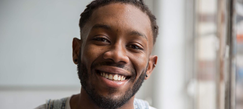A portrait of a smiling man
