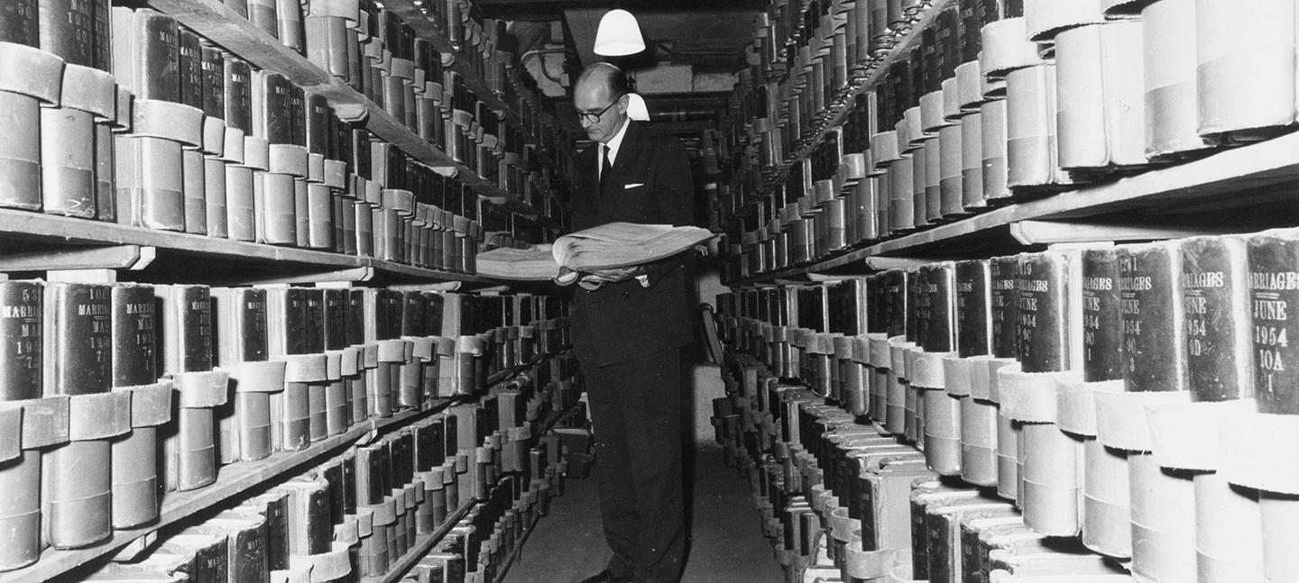 A black and white photo of the Registrar General in the vaults of Somerset House.