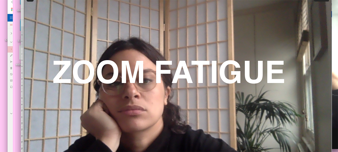A photo of a woman looking bored while on a zoom call. There is text overlaid which reads 'ZOOM FATIGUE'