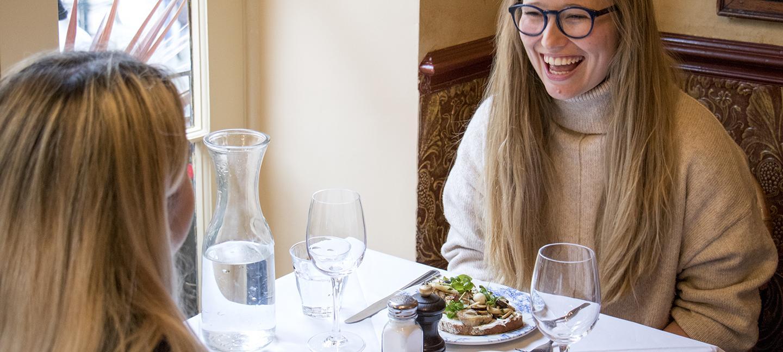 Woman laughing in Boulevard Brasserie restaurant