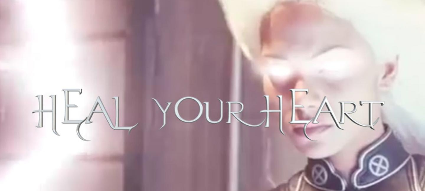 A picture of a face with white light in top right corner, with text over the top that says 'Heal your heart'