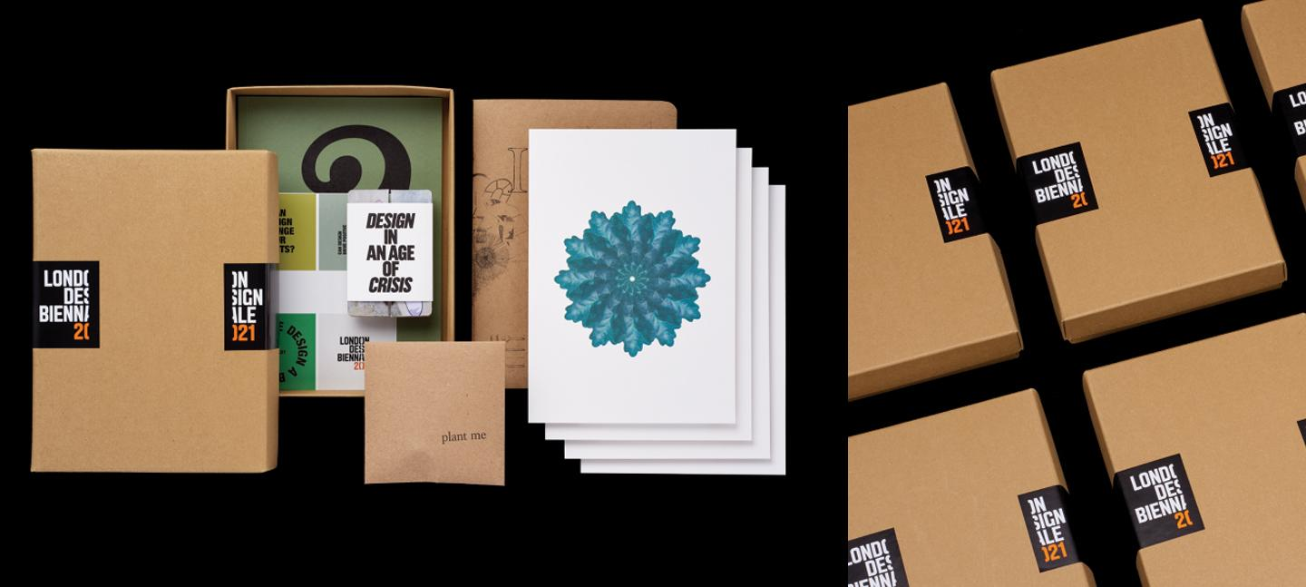 A photo of the souvenir box for London Design Biennale. It shows an art print, playing cards and some neatly placed packaging.