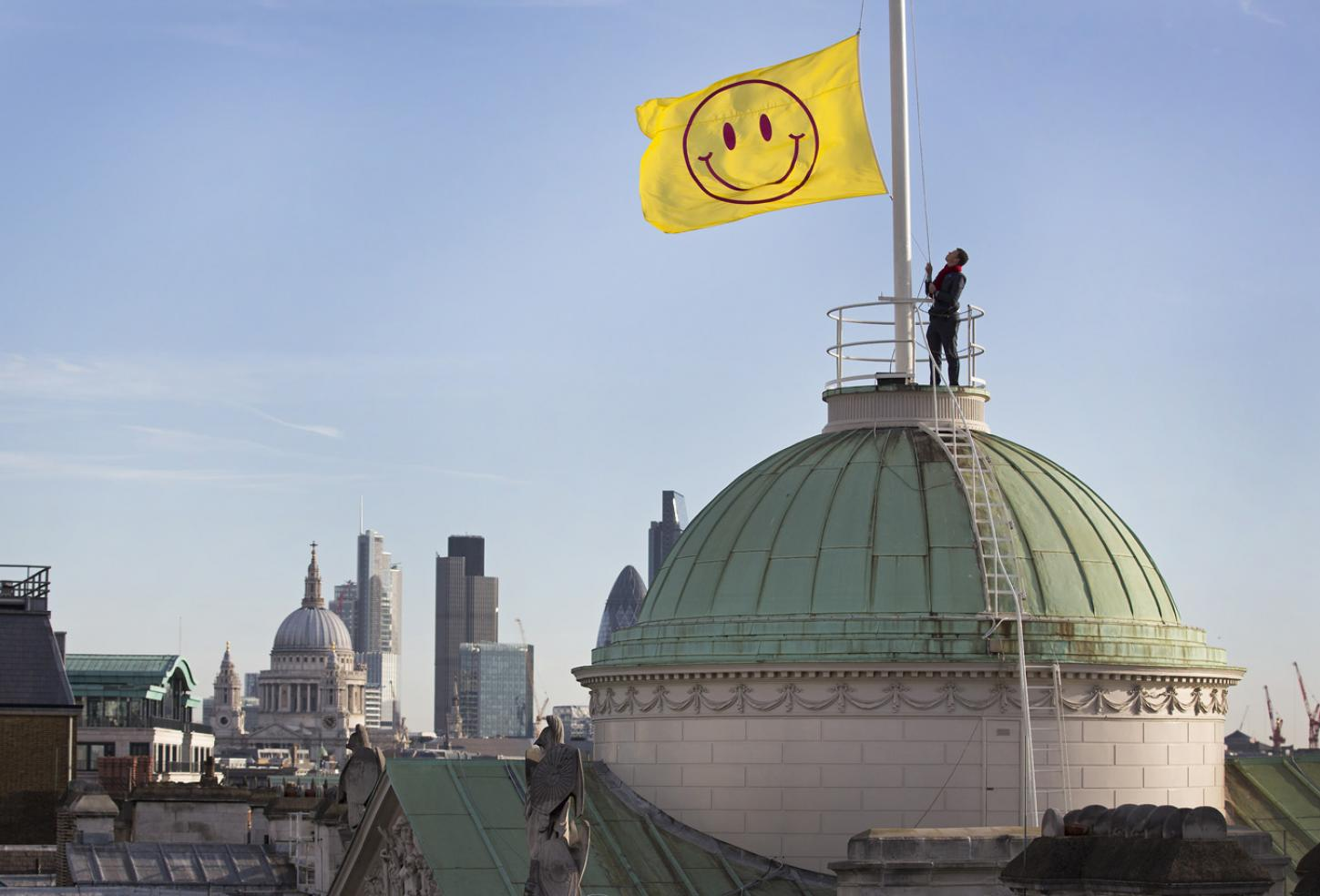 A flag designed by Jeremy Deller and Fraser Muggeridge studio is raised to the top of Somerset House as part of the launch of 'UTOPIA 2016 - A Year of Imagination and Possibility'