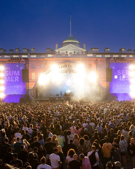 Crowd lit up by stage lights at Somerset House Summer Series with American Express