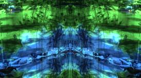 A computer generated image of symmetrical shapes and lines, green and blue.