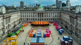Dodge at Somerset House, showing bumper cars and passengers in the courtyard