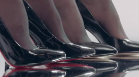 4 sets of feet wearing patent leather stiletto shoes and black stockings