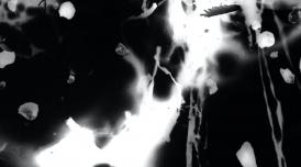 A still from Kathy Hinde's film River Traces. It shows inky light exposure on a black background