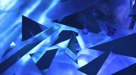 An artwork by Lila Tirando e Violeta called Silicon Realms. It shows lots of sharp angled, shadowed 3D shapes in blue
