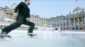 Person skating on the ice rink at Somerset House