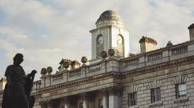 A photo of the roof of Somerset House with blue skies