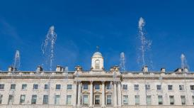 A photo of Somerset House against a backdrop of blue skies.