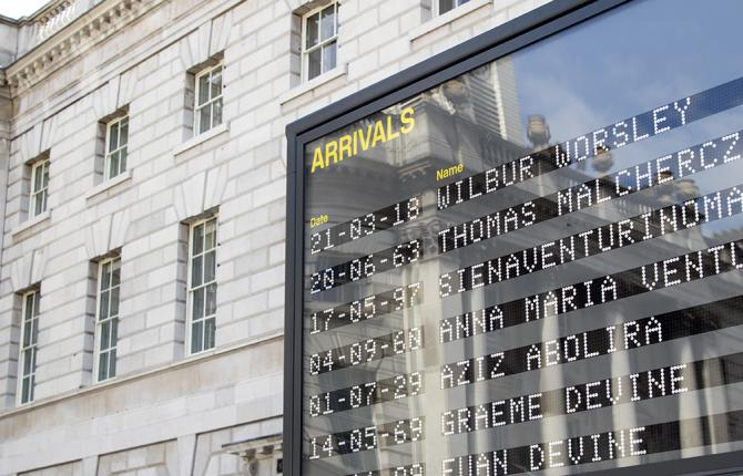 An install photo of the Arrivals board in Somerset House's courtyard