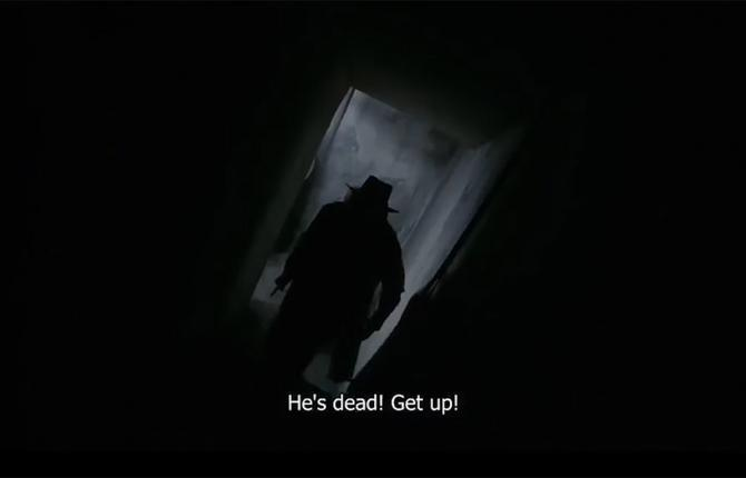A black and white photo of a man in a doorway. Text at bottom reads: He's dead! Get up!