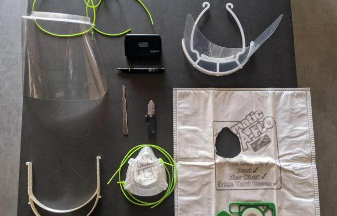 A photo of PPE equipment, including a plastic visor and face mask