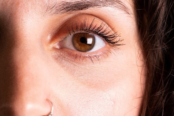 A photo of a close up of a woman's eye
